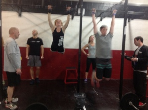 one of our members kicking ass on the chest to bar pull ups
